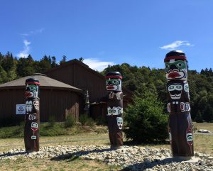 Three totem poles greet visitors to the Nuyambalees Cultural Center in Cape Mudge on Quadra Island.