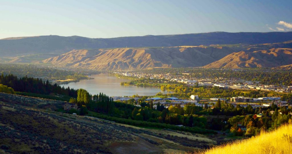 A view of my home town, Wenatchee, in Eastern Washington. The river seen here is Mighty Mother Columbia. The Wenatchee River, where my family lived, enters her at bottom right.