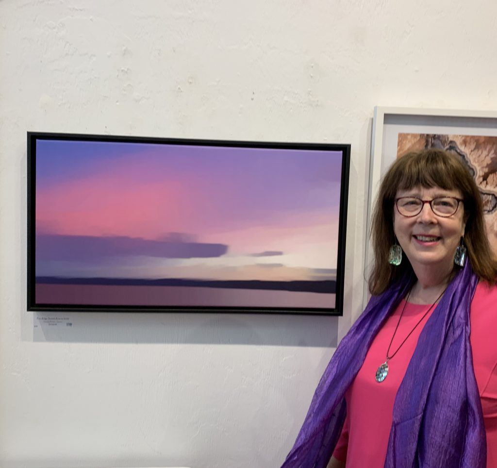 Sandy Brown Jensen showing her submission at the Photography at the Emerald national Juried Show 2019