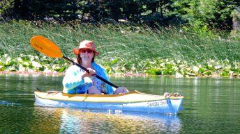 Sandy Brown Jensen doing nothing in a kayak on Hosmer Lake